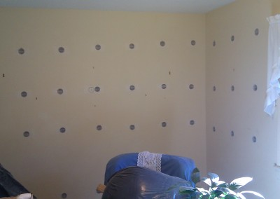 Drilling holes for each wall stud bay